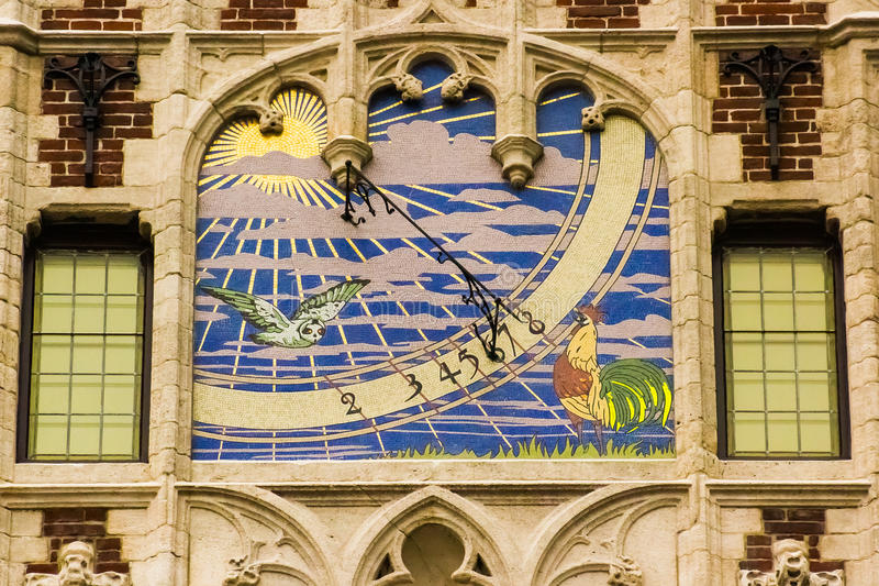 Sun watch from 1895 in Brussels. Sun watch in Coudenberg Street, Brussels, Belgium, in the facade of an old pharmacy. Built in 1895 by Silvio Tolomei with royalty free stock images