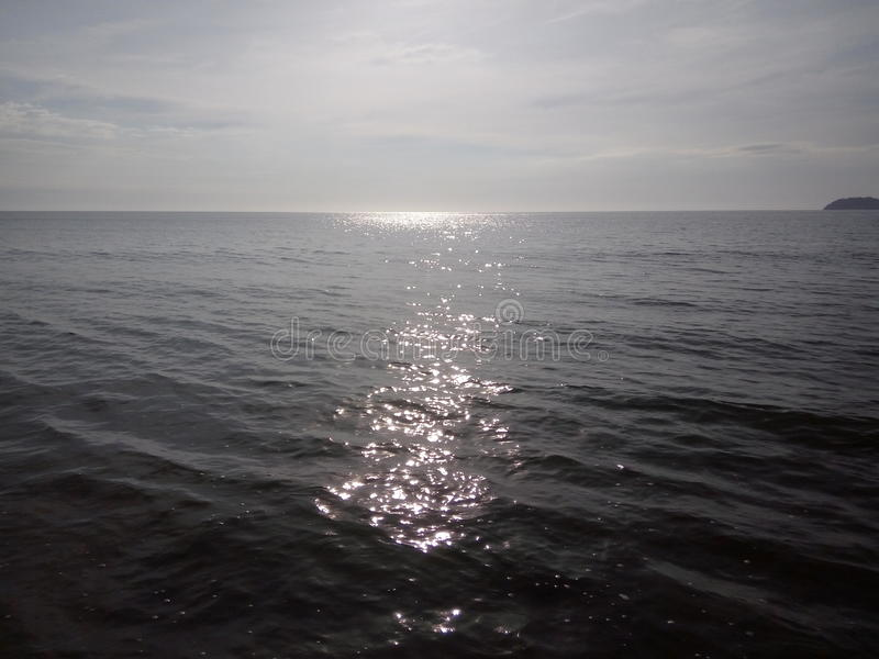 Sun on water, Kota Kinabalu, Malaysia. Sunlight reflecting off the water, Kota Kinabalu, Malaysia (Borneo stock images