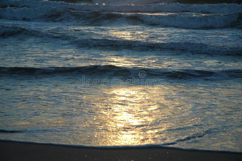 Sun on the waves stock image
