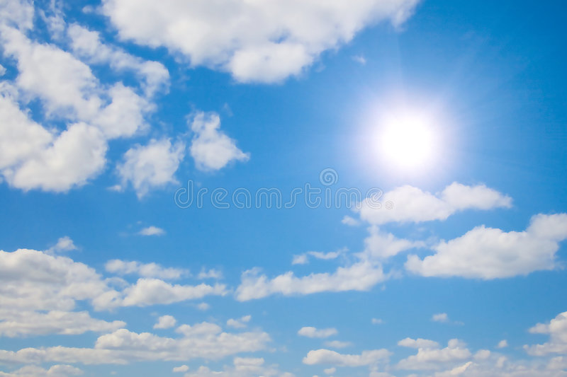 Sun and white clouds in sky stock image
