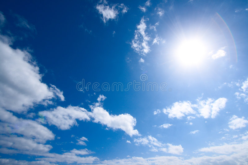 Sun and white clouds in sky royalty free stock photo