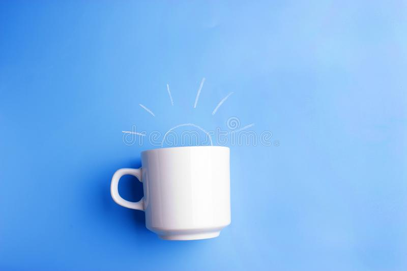 sun and white cup on blue background stock image