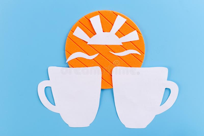 sun and white cup on blue background royalty free stock photos