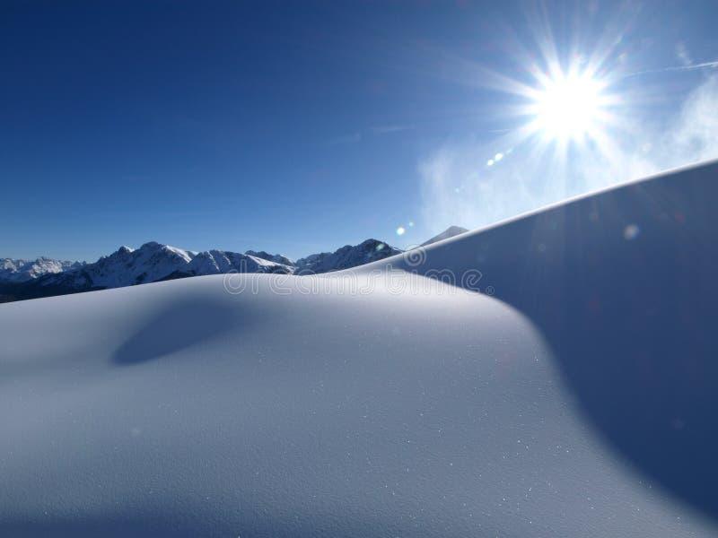 Sun y nieve fotos de archivo