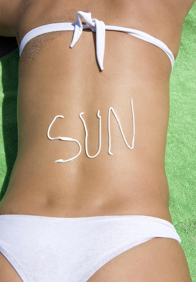 Download Sunbaking Woman Word Written Sunlotion On Back Stock Image - Image: 12422151