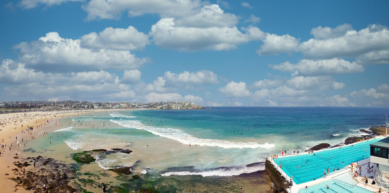 Sunbathers and swimmers on the Bondi Beach in Sydney, Australia.  stock photos