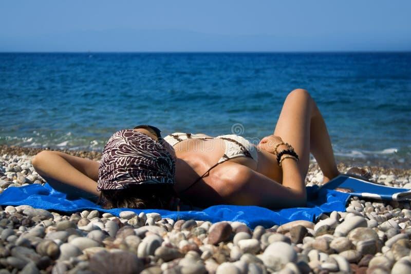 Sunbathing imagem de stock