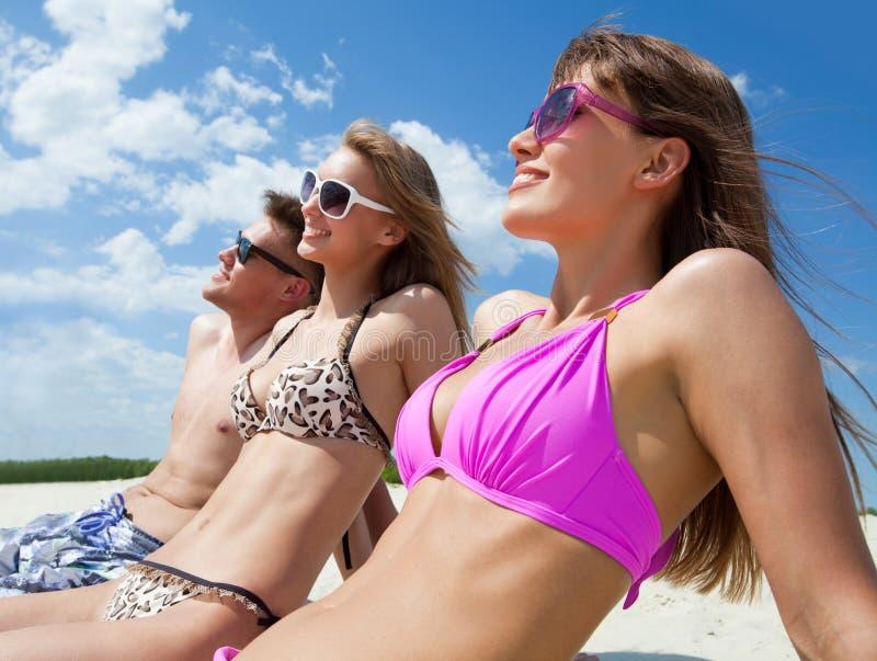 sunbathing photo stock