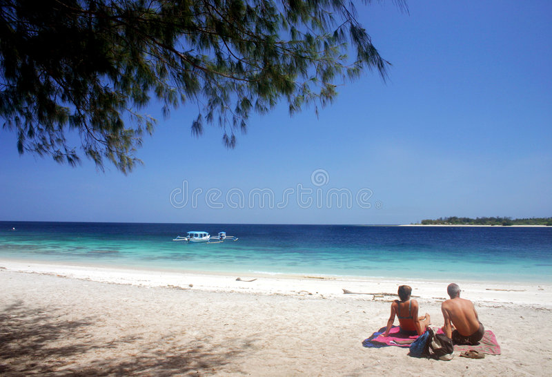 Sunbathing at Kuta Beach royalty free stock photos