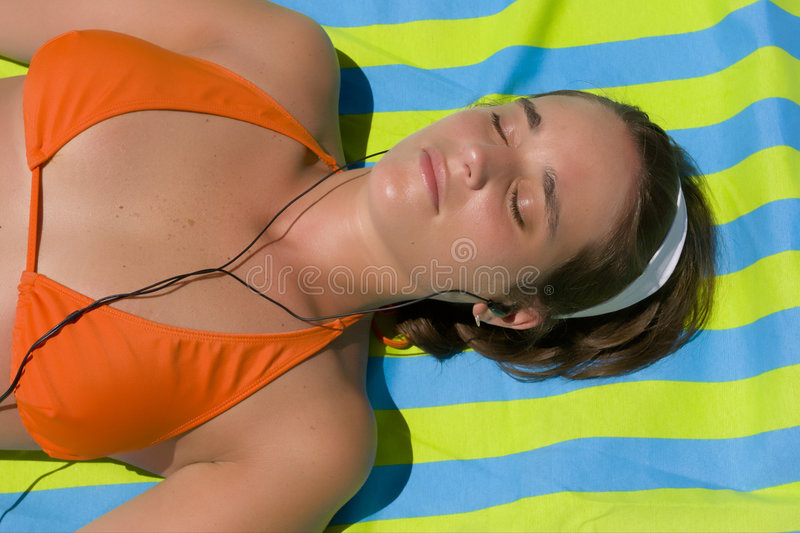 Sunbathing And Music Royalty Free Stock Photography