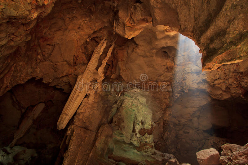 Download Sunbeam into the cave stock photo. Image of mountain - 34204920