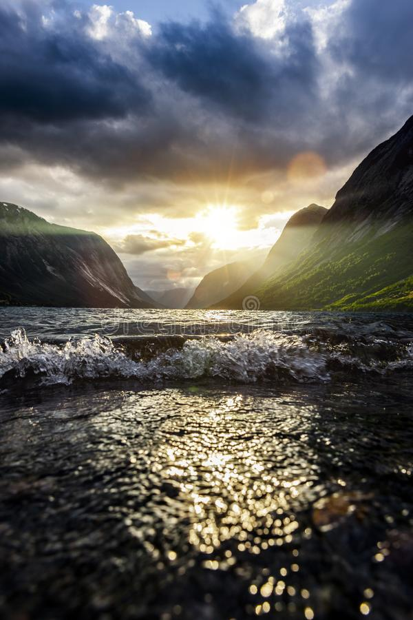 Sunbeam at a fjord stock photos