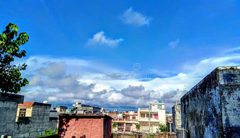 Sunbeam passing through the cloud over Chiangrai city withthe areal shot has been taken thr. Beautiful, cityscape. Sunset over a highly-populated city royalty free stock photography