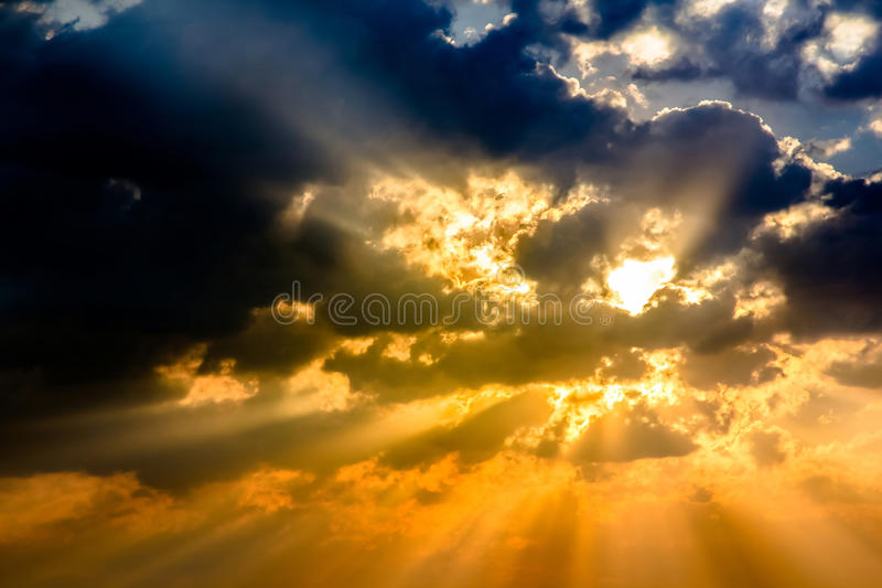 Sunbeam ray light cloud sky twilight color. Sunbeam ray light through cloud sky twilight color blue and orange Dramatic background royalty free stock images