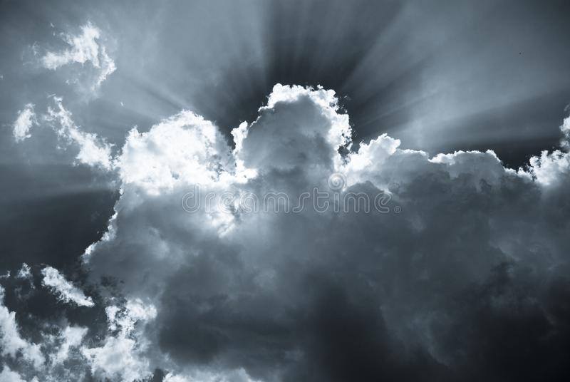 Sunbeams behind the clouds on a spring stock photos