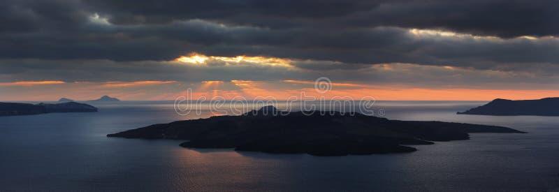 Sunbeams over Santorini volcano. Panorama royalty free stock images