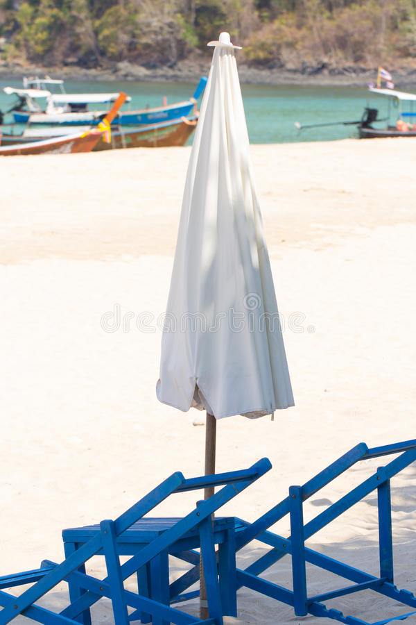 Sunbed and umbrella stock photo