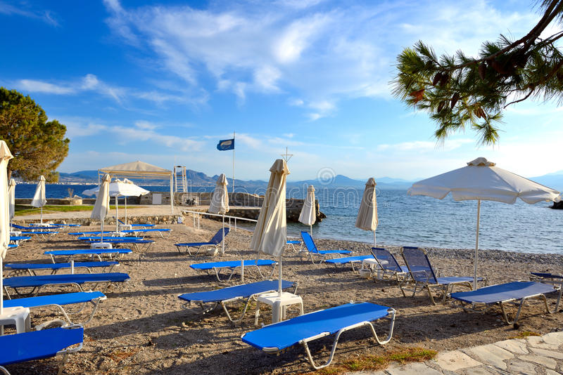 Sunbeds on the beach at luxury hotel. Peloponnes, Greece royalty free stock photos