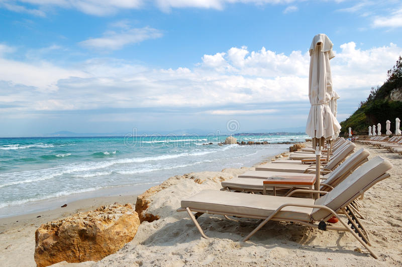 Download Sunbeds On A Beach And Turquoise Water Stock Image - Image: 26402051