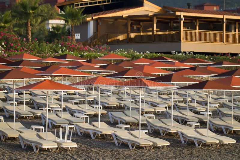 Download Sunbeds And Beach Umbrellas Stock Photos - Image: 17898323