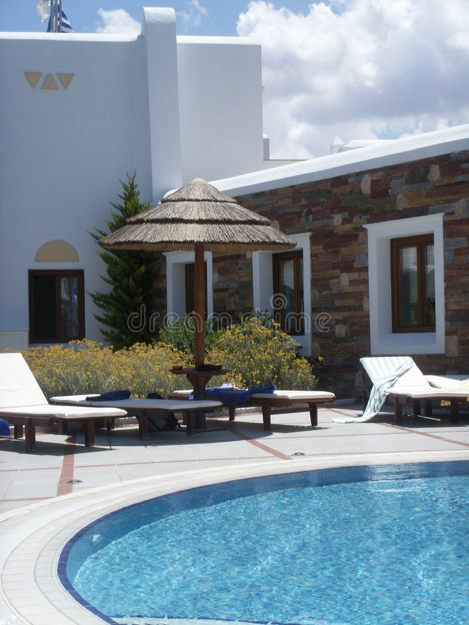 Download Sunbeds And Hut By The Pool Stock Photo - Image: 915538
