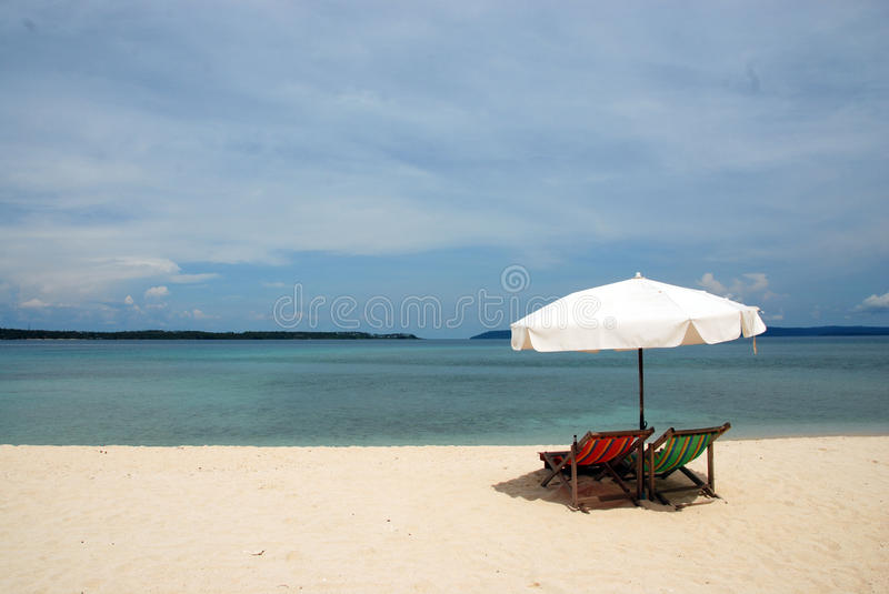 Download Sunbeds on a remote beach stock image. Image of vacation - 26576731