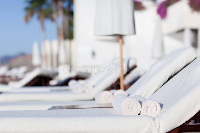 Download Sunbeds at the resort stock image. Image of modern, summer - 26119161