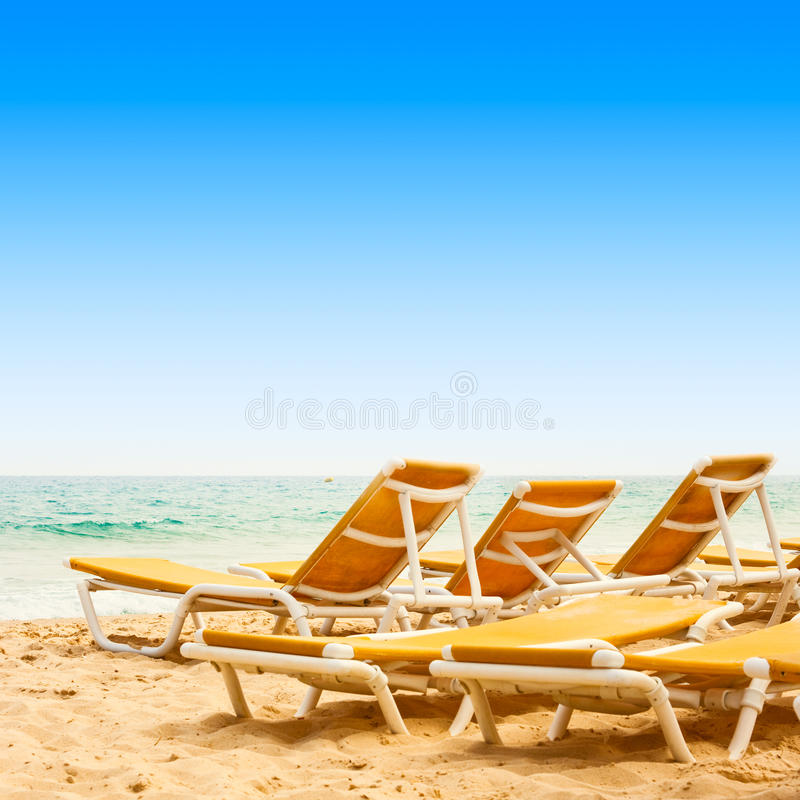 Download Sunbeds on the sandy beach stock photo. Image of color - 20756852