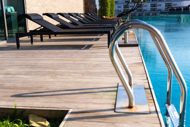 Sunbeds and spa relaxation at poolside stock images