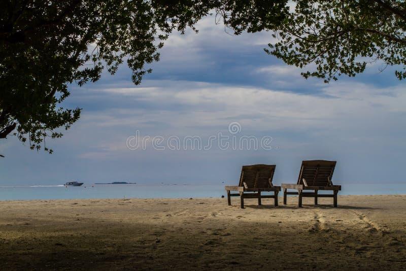 Sunbeds in sunset on a tropical beach stock photos