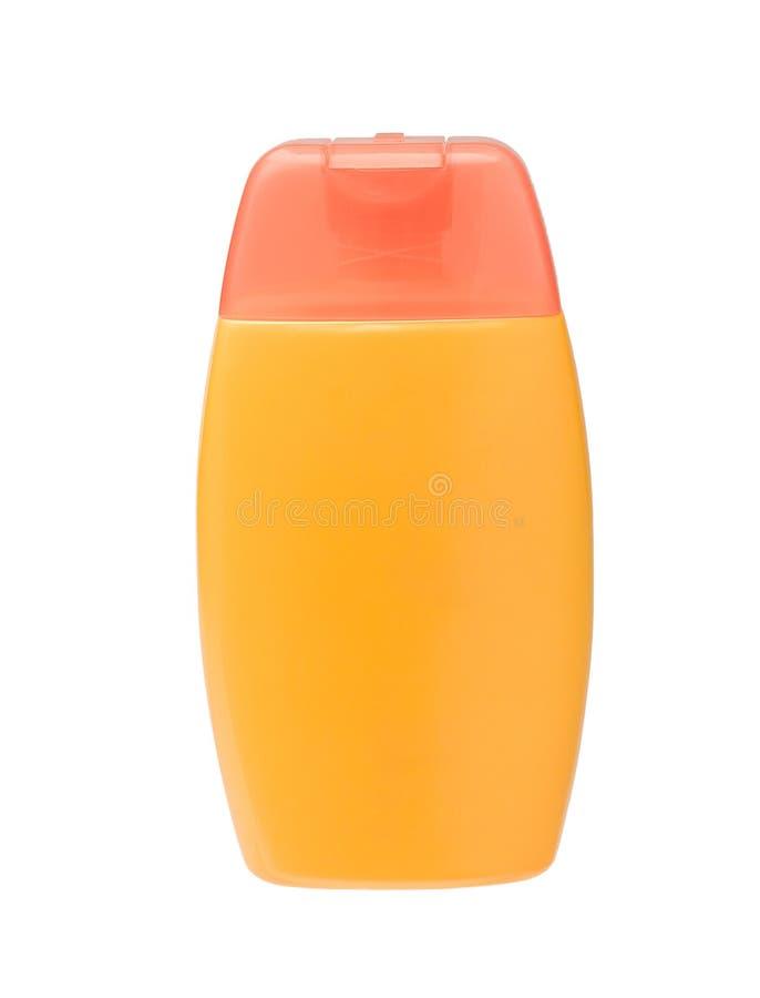 Sunblock flaska med den blanka etiketten arkivfoton
