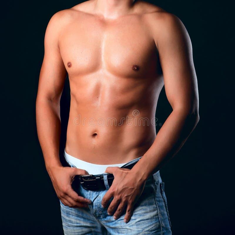 Sunburnt muscular male torso stock images