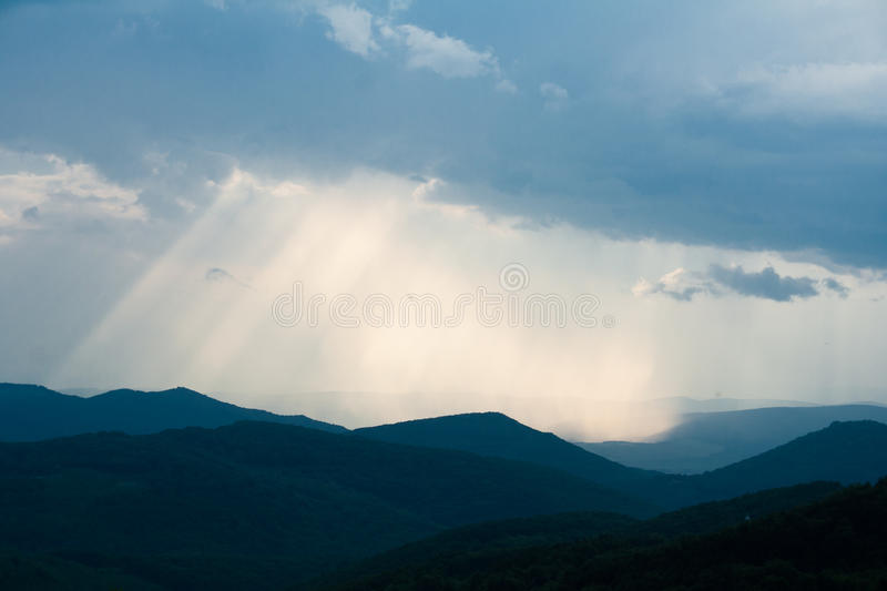 Sunburst. Cloudy sky with sunburst in the mountens royalty free stock photo