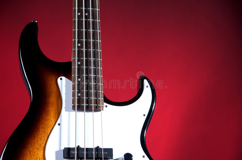 Download Sunburst Bass Guitar Isolated On Red Stock Photo - Image: 7159206