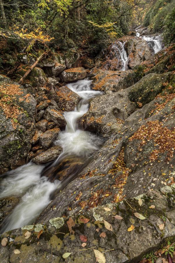 Sunburst Falls. North Carolina. Beautiful cascading waterfall right along NC 215 just a few miles north of the Blue Ridge Parkway. Seen here with autumn colors royalty free stock photo