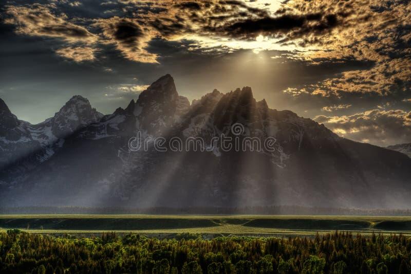 Sunburst over Grand Tetons stock images