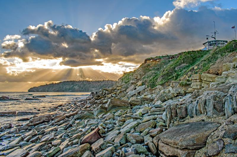 Sunburst through the clouds at Peveril Point Swanage December 2017. Sunburst at Peveril Point, Swanage in December 2017 royalty free stock photos