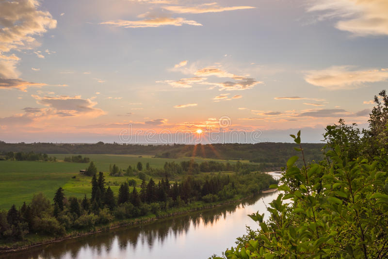 Sunburst Setting Above Red deer River stock images