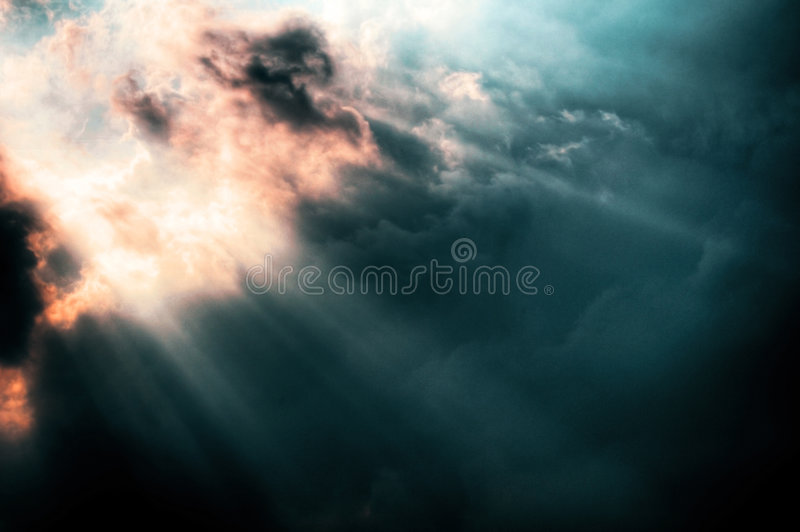 Sunbursts through storm clouds stock photos