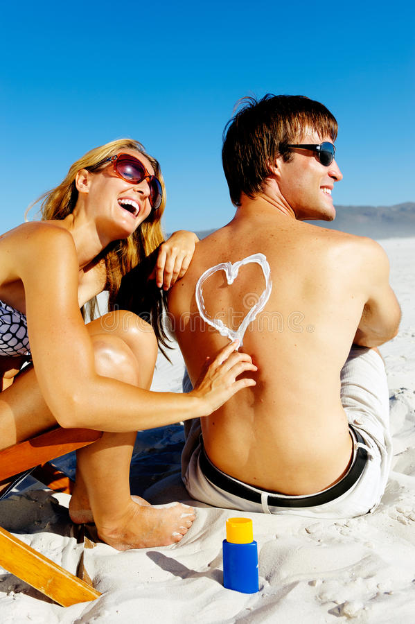 Download Suncare beach couple stock photo. Image of apply, lifestyle - 23871734