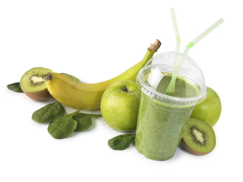 Sund grön smoothie med frukt royaltyfri foto