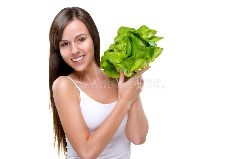Sund livsstil! Äta massor av grönsaker royaltyfri fotografi