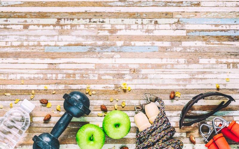 Sund livsstil, sund mat, sportutrustning, equi för idrottsman nen` s royaltyfri bild