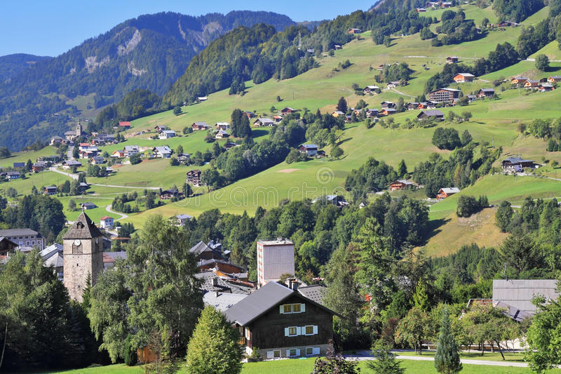 The Sunday afternoon in the Haute-Savoie. The charming landscape in the French Alps. Sunny Sunday afternoon in the Haute-Savoie. Green alpine meadows and lovely royalty free stock photography