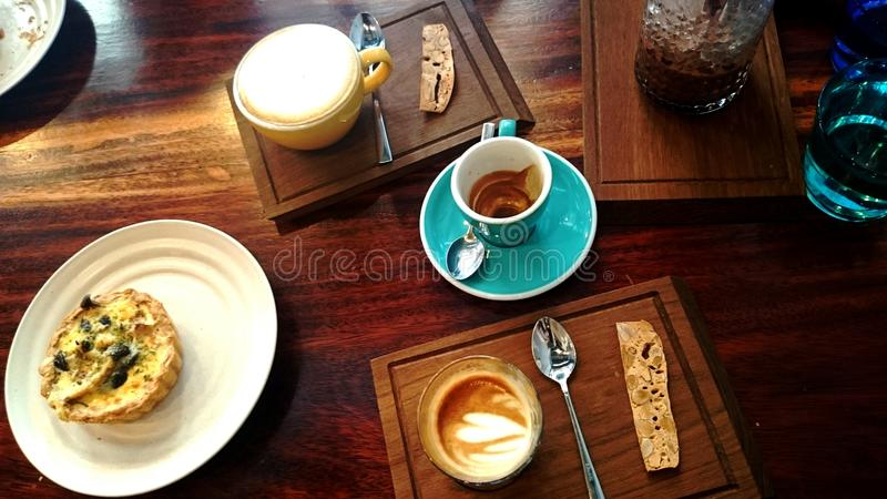 brunch with coffee quiche with colourful cup on wood table royalty free stock photography