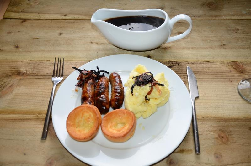 Sunday lunch, sausage and mash potato stock images