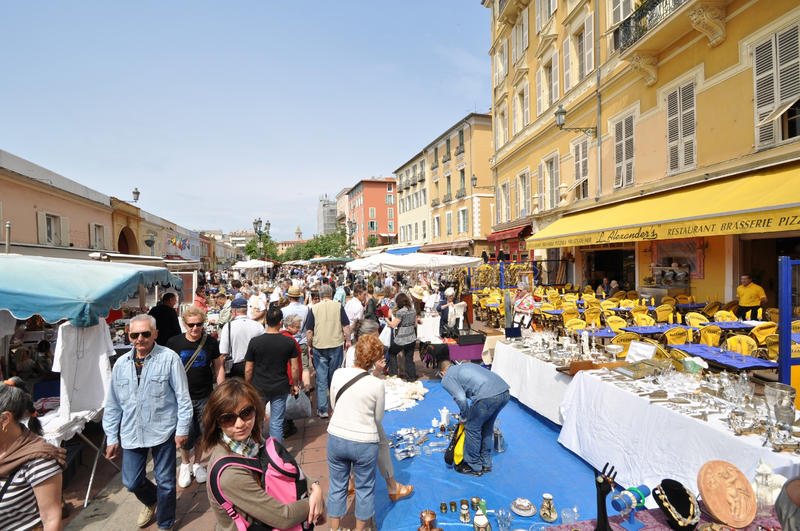 Weekend market, Nice, France. Nice, France - May 4, 2009: Many tourists and local people visit weekend market in Nice, France royalty free stock images