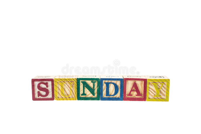 Sunday written in letter colorful alphabet blocks isolated on white. Background stock photos