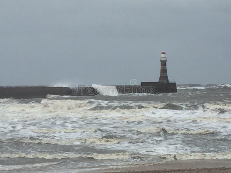 Stormy weather. Sunderland. Rocker pier. Lighthouse. Storms stock photography