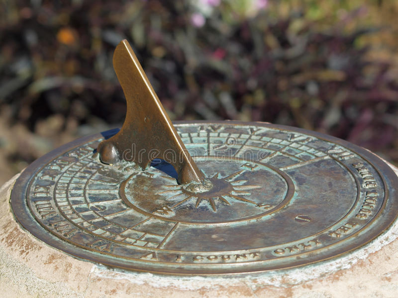 Sundial. Close-up of antique sundial decorating a garden royalty free stock images
